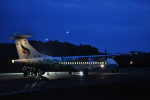 Flight PG308 on runway at night at Trat Airport